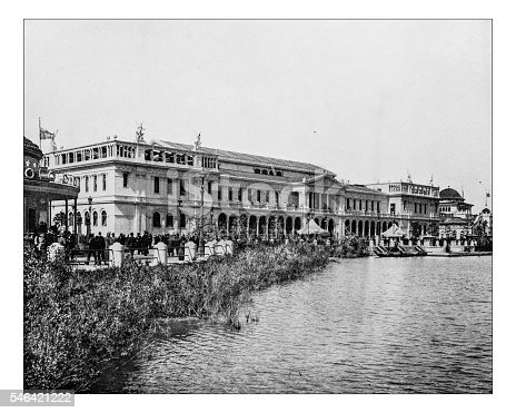 Antique photograph of the so-called Woman's building at the World's Columbian Exposition held in Chicago (USA) in 1893. In the picture the massive neoclassical building overlooking the promenade crwowded with visitors and the Lake Michigan.The building was destroyed following the closing of the fair