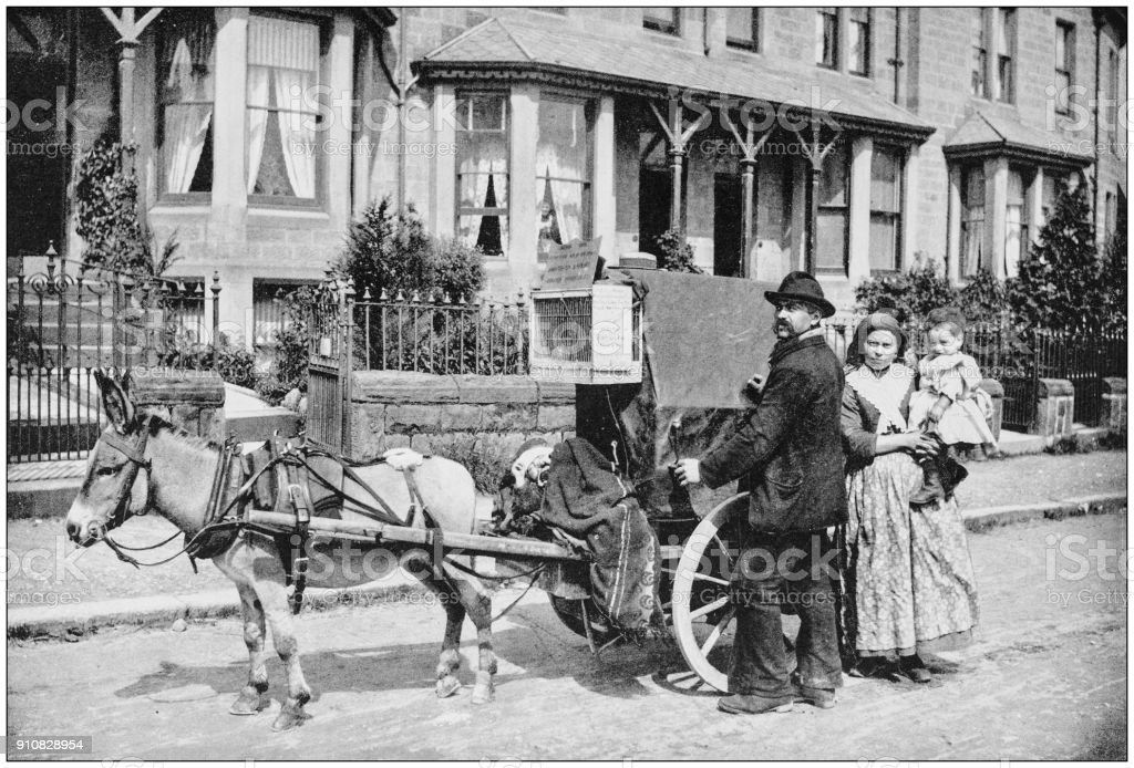 Antique photograph of World's famous sites: Organ Grinder stock photo