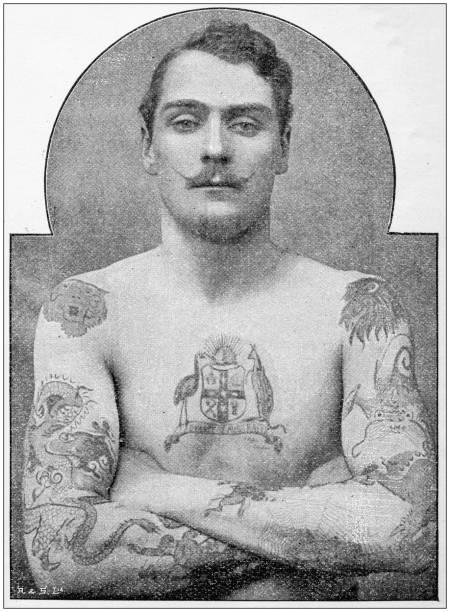 antikes foto: tattoos, australier/in - männliche körperkunst stock-fotos und bilder