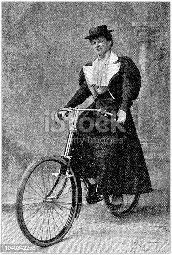 Antique photograph: Woman on bike