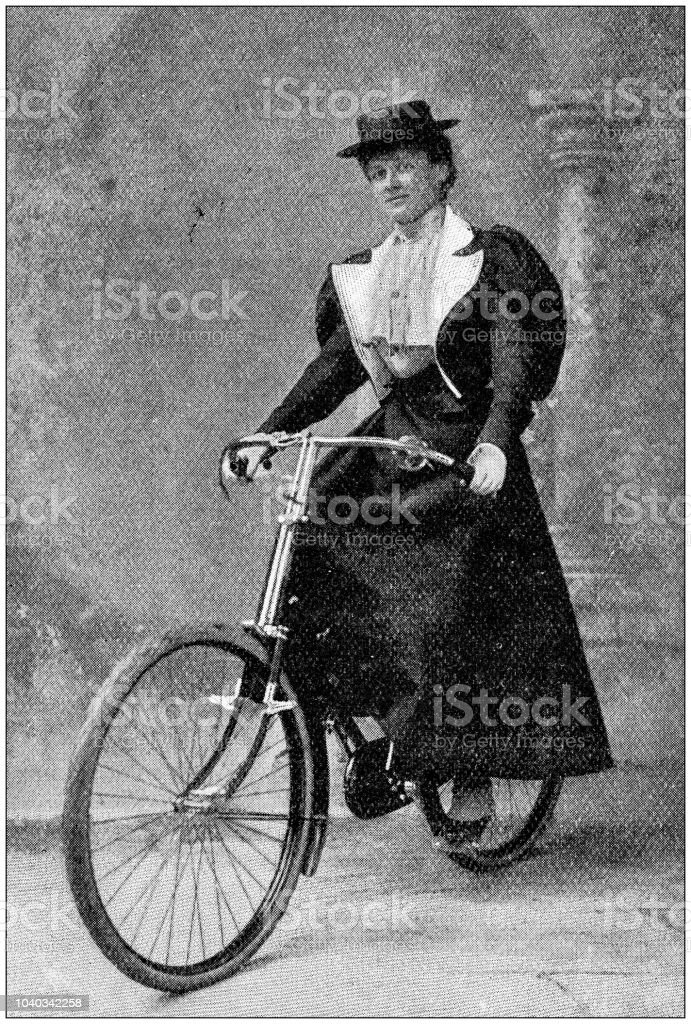 Antique photograph: Woman on bike stock photo