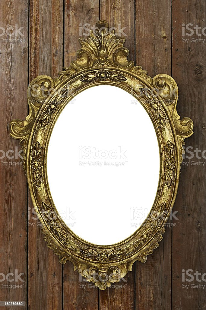 Antique Picture Frame Blank ellipse antique picture (or mirror) frame on old wooden wall with white copy space. Antique Stock Photo