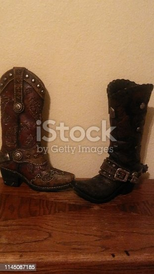 Beautiful old antique cowboy boots figures