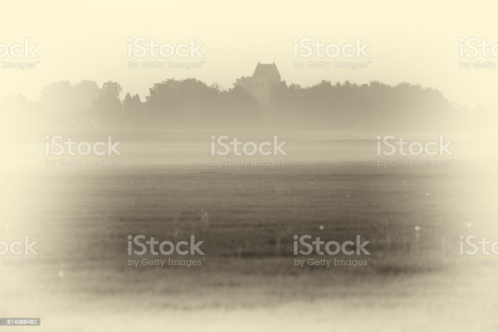 Antique plate photography of dutch old churchtower in mist. Small rural village. stock photo