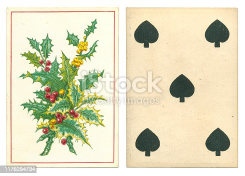 Out of copyright. 19th century antique playing card with festive / Christmas back design by UK manufacturer de la Rue. The pretty back design shows green holly with orange and red berries, and follows on from famous designs by Owen Jones in the mid-1850s. The card is a five of spades with no indices and square corners, typical of the time, and appears to be non-reversible.