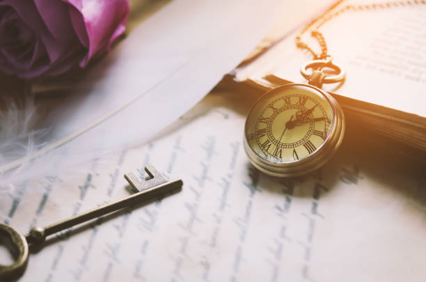 Antique pocket watch and old vintage key with vintage tone stock photo