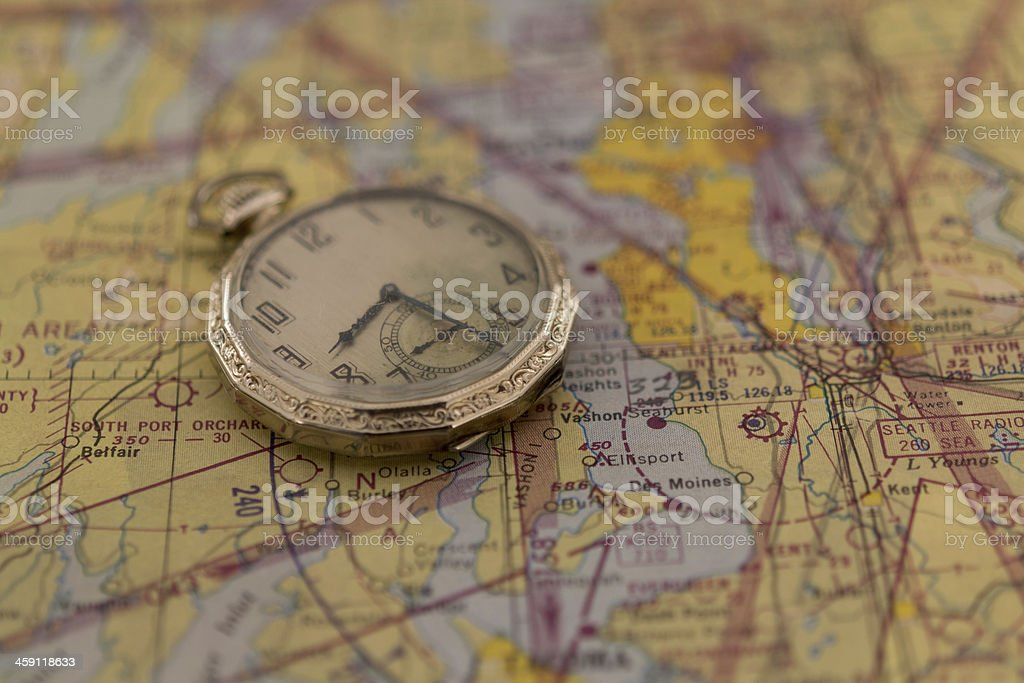Antique Pocket Watch on Old Map royalty-free stock photo