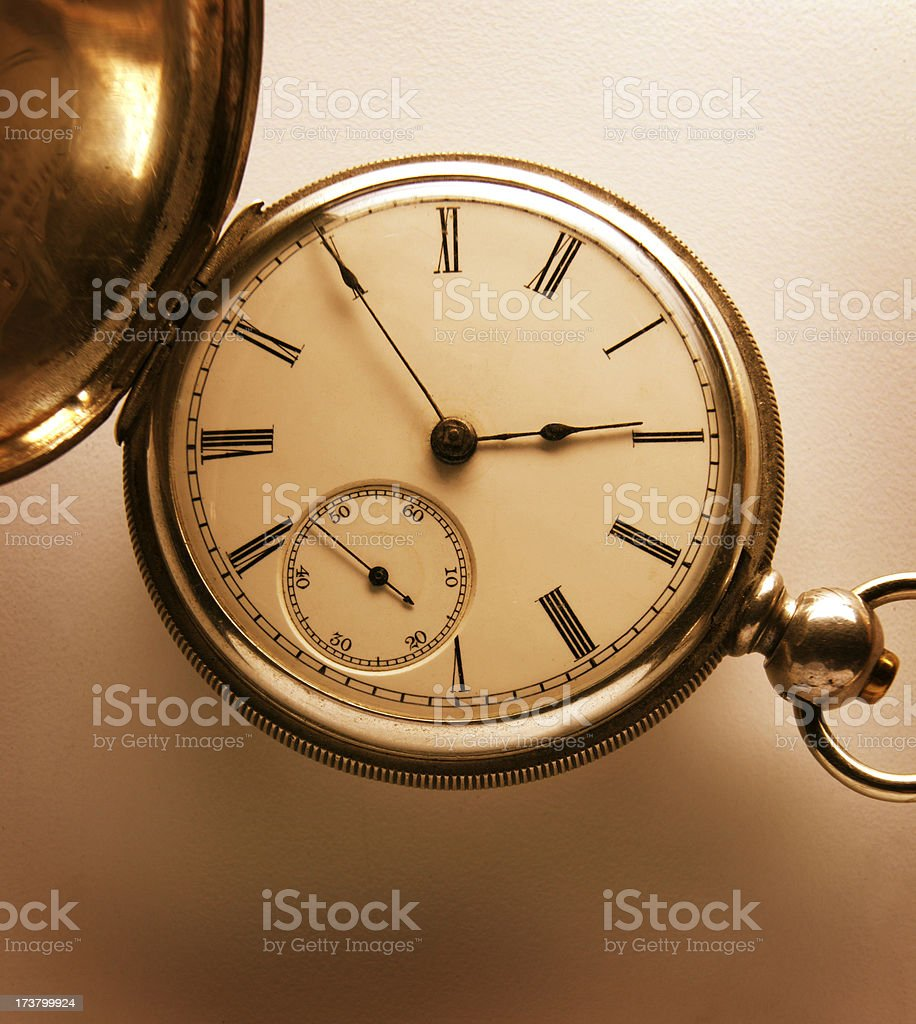 Antique pocket watch on simple background royalty-free stock photo