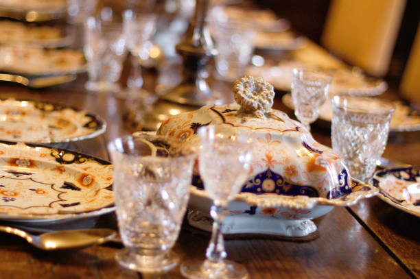 Antique porcelain an glasses on a dining table. English. stock photo
