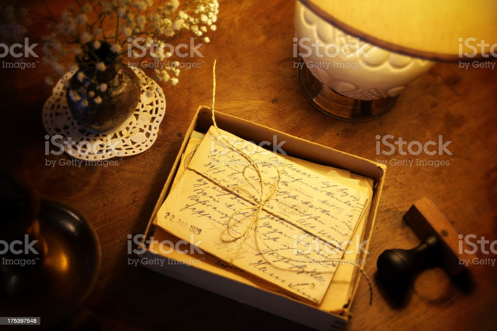 Antique postcards and mail envelops on a wooden desk stock photo