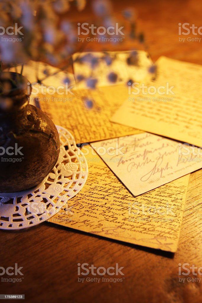 Antique postcards on wooden desk stock photo