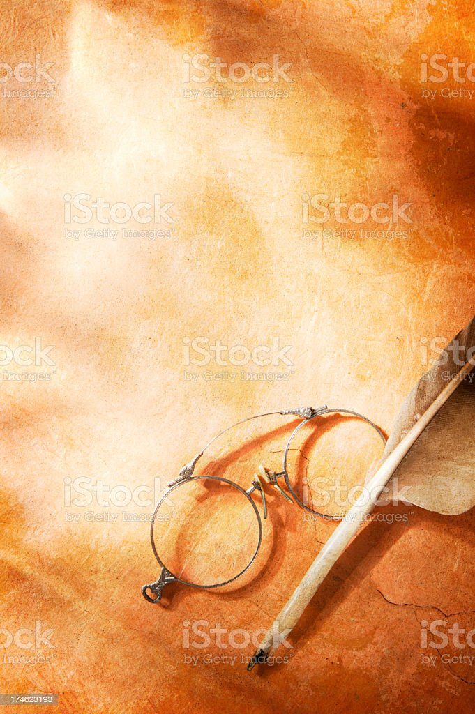 Antique Quill and Glasses On Textured Surface royalty-free stock photo