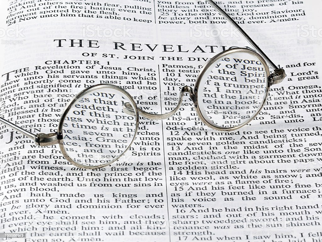Antique reading glasses on page of bible royalty-free stock photo