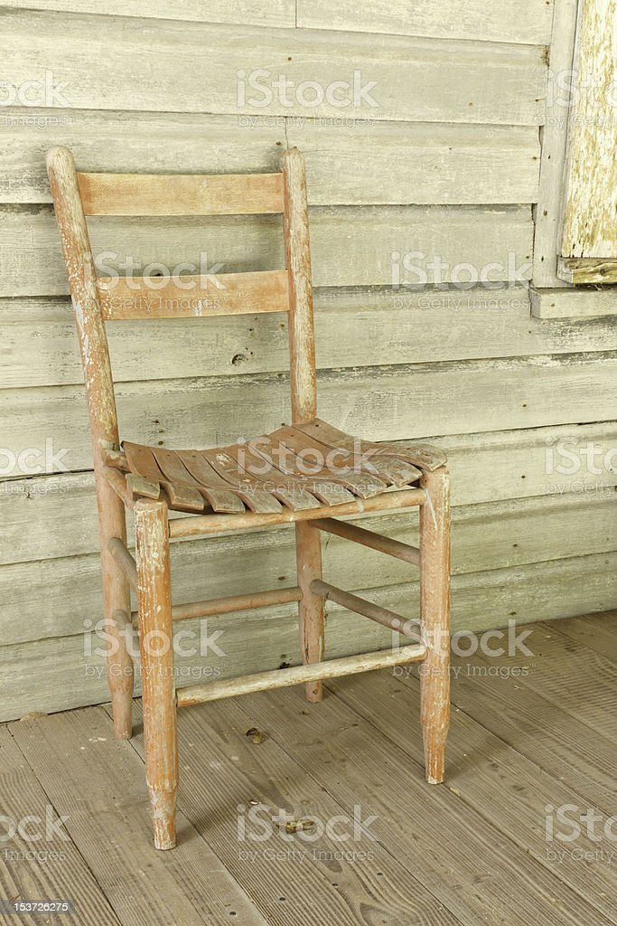 Antique Red Chair In Rustic Setting royalty-free stock photo