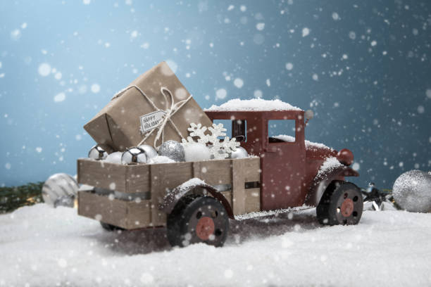 Antique Red pickup Truck in the snow with gift in the back stock photo