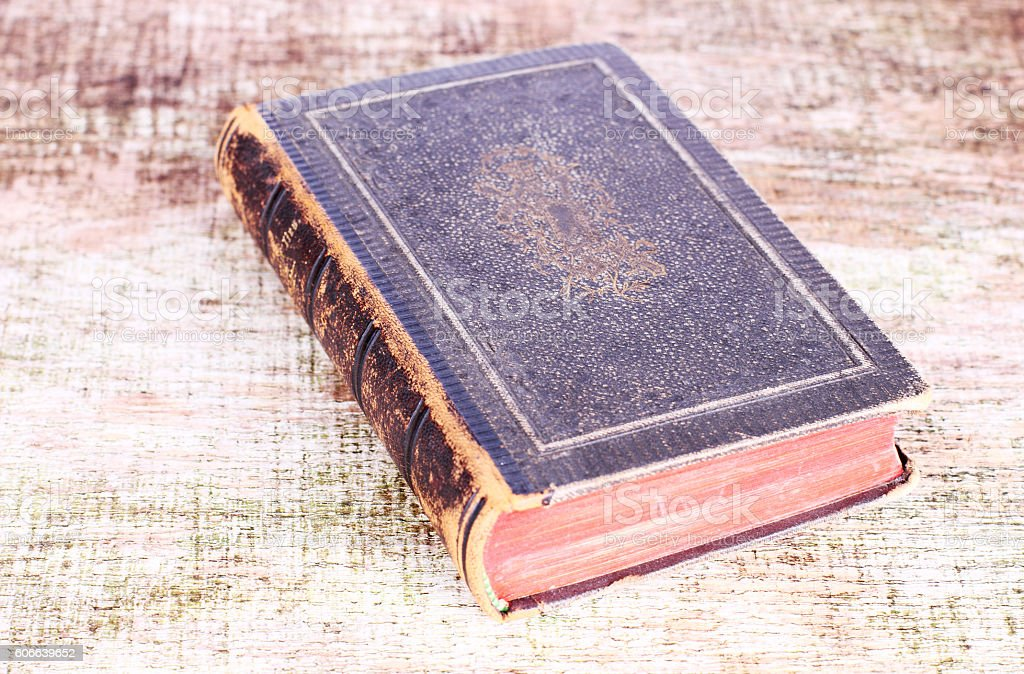 Antique Religious Book flying on Old Wooden Table stock photo