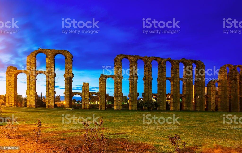 antique  Roman Aqueduct of Merida in evening stock photo