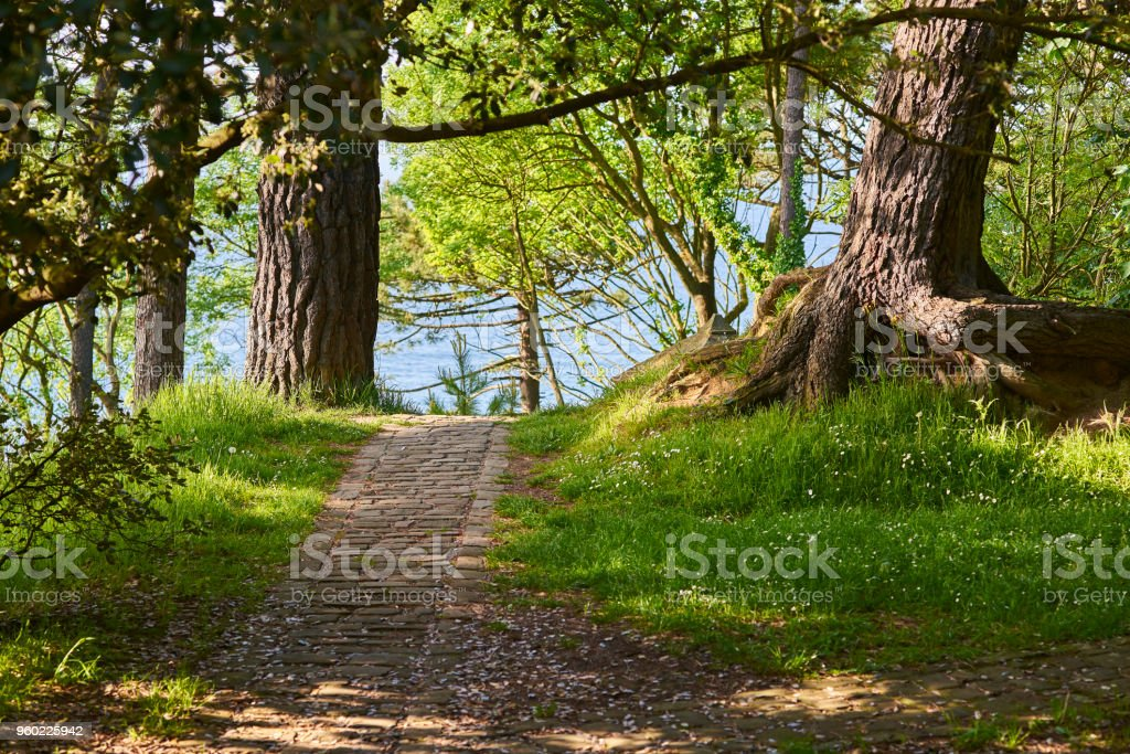 Antique roman road remains with the sea in background. stock photo