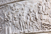 istock Antique roman soldiers from Trajan Column in Rome 478853479