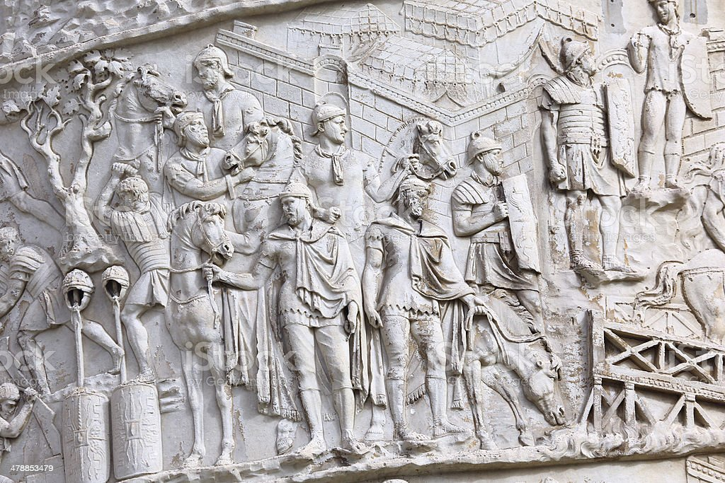 Antique roman soldiers from Trajan Column in Rome stock photo