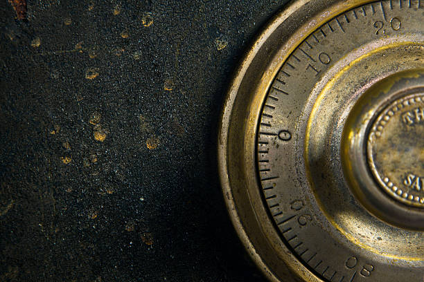 Antique Safe Close-up of a combination dial on an antique safe. security equipment stock pictures, royalty-free photos & images