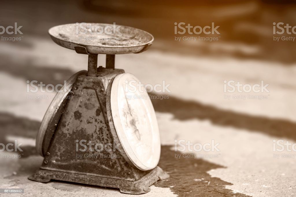 Antique scales put on cement floor.Vintage scales, Old scales. stock photo