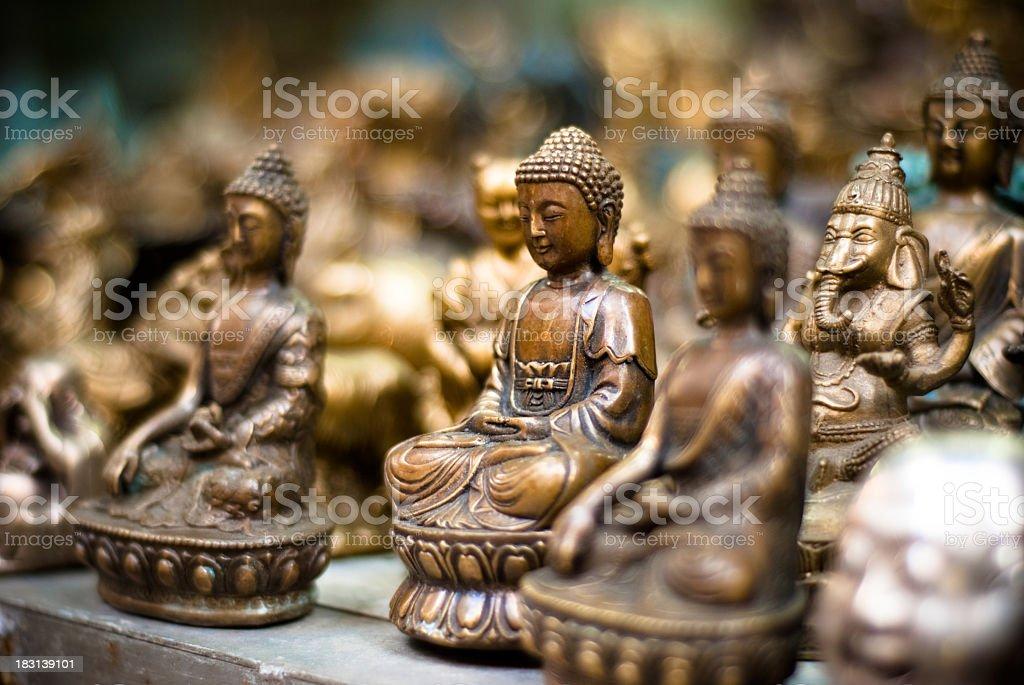antique sculpture of buddha stock photo