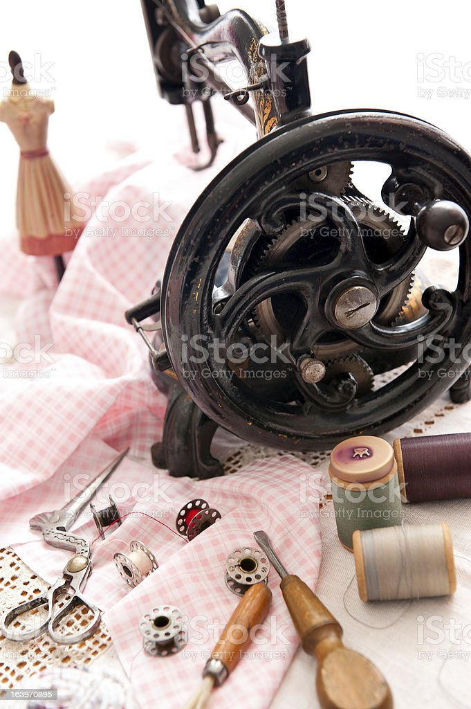 Antique sewing machine and kit royalty-free stock photo