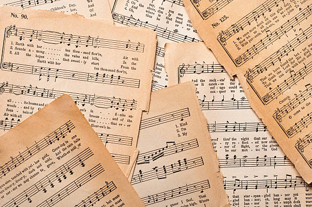 Antique Sheet Music Old sheet music on parchment paper from an antique hymnal.  The printing is copyrighted 1890 and is in the public domain. sheet music stock pictures, royalty-free photos & images