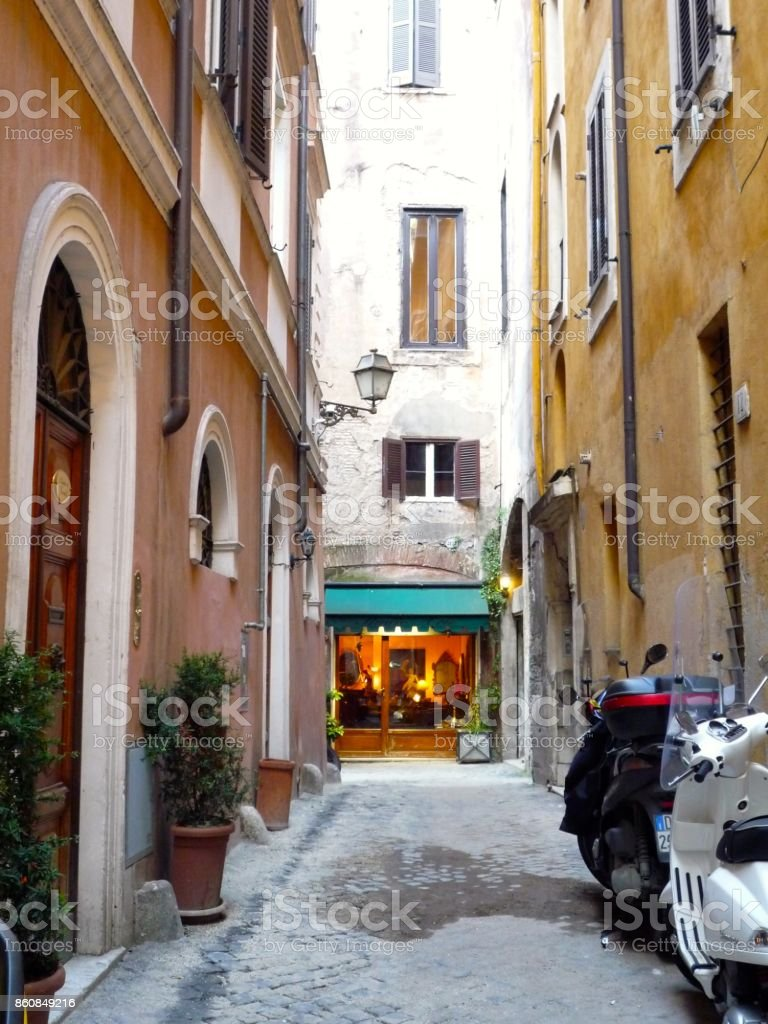 Antique shop in alleyway of rome stock photo