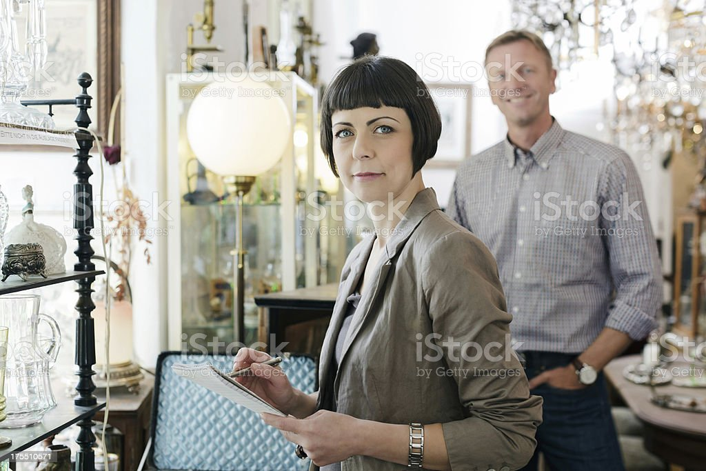 Antique shop owners stock photo