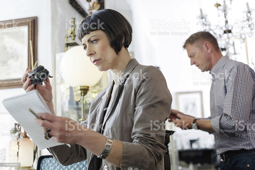 Antique shop owners taking inventory stock photo
