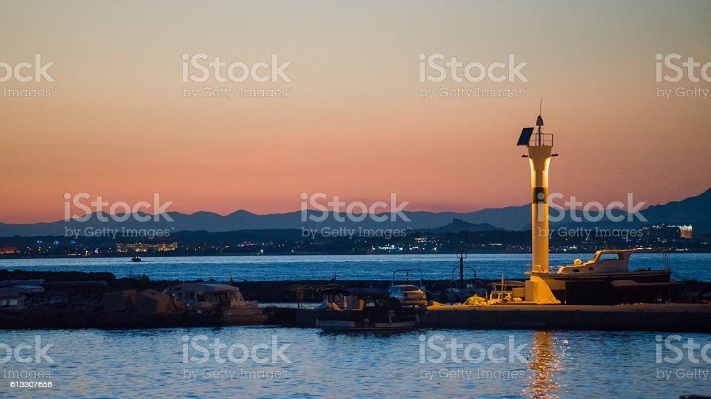 antique Side  Turkey  lighthouse at sunset stock photo