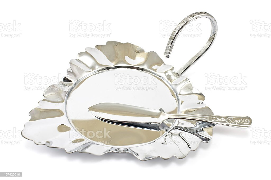 Antique silver plate with knife royalty-free stock photo
