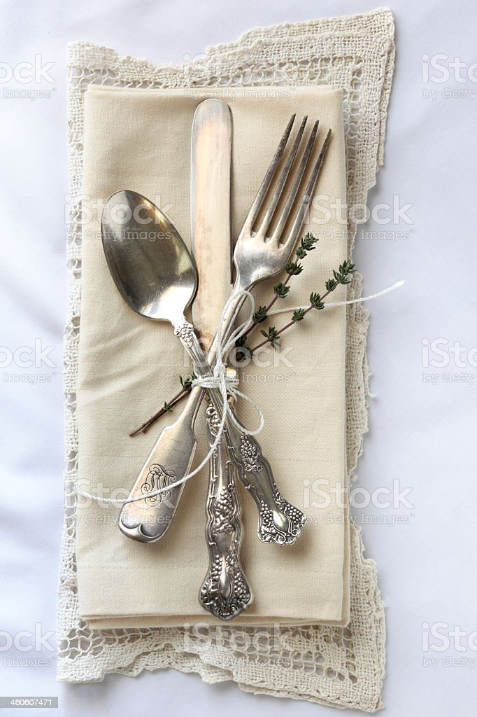 Antique silverware with a beautiful patina arranged as a place...