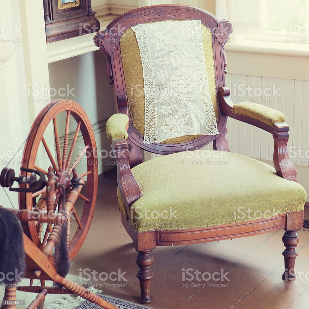 Antique Sitting Chair and Spinning Wheel stock photo