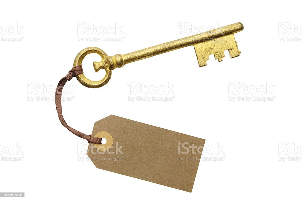 Antique skeleton key with blank brown tag on white background royalty-free stock photo