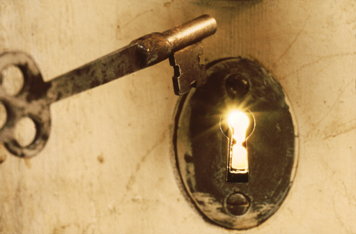 Antique Skeleton Key With Light Beams from Keyhole
