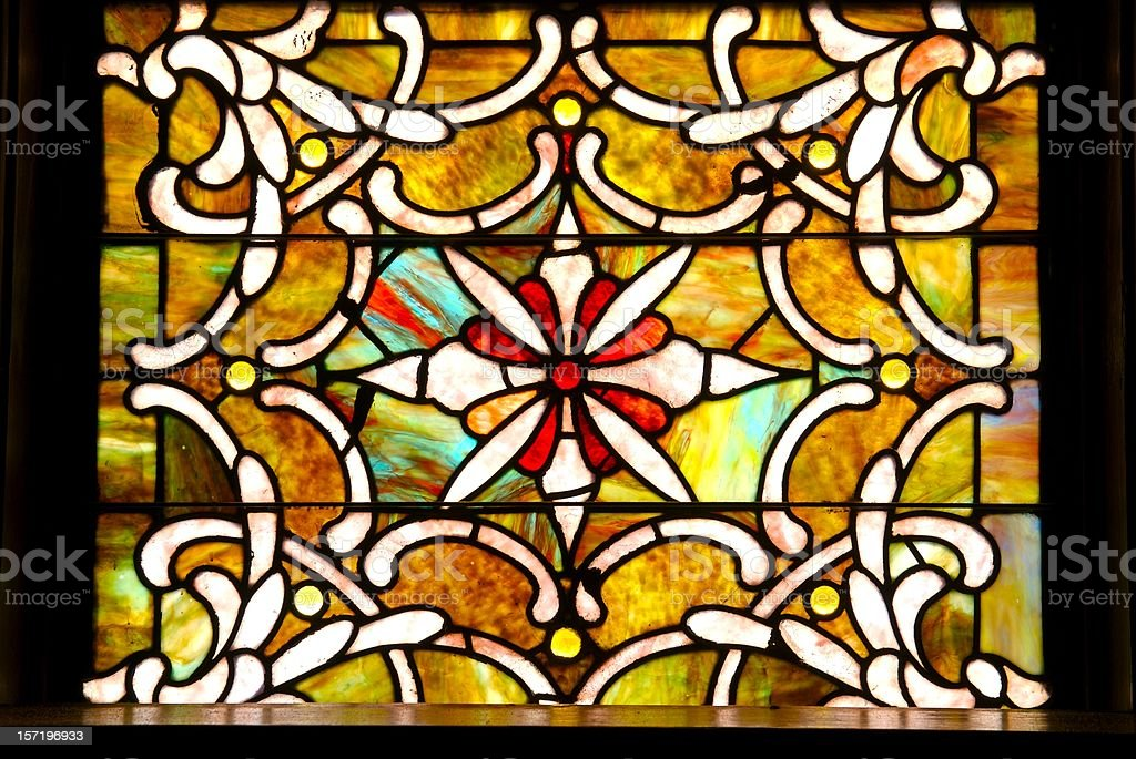 Antique stained glass window in sanctuary  royalty-free stock photo
