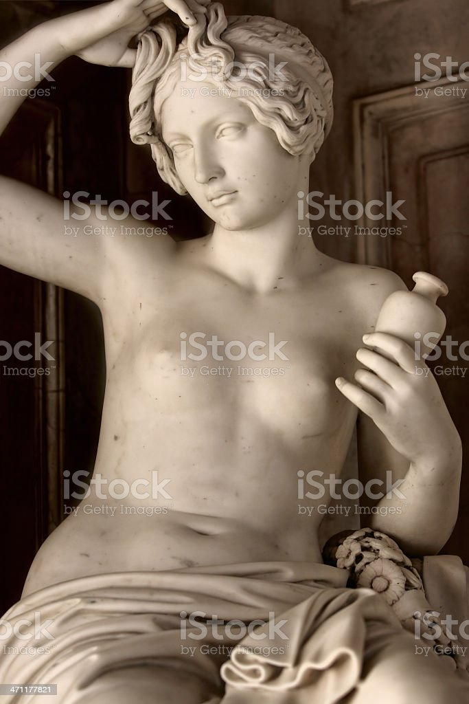 Antique statue of young woman washing her hair royalty-free stock photo