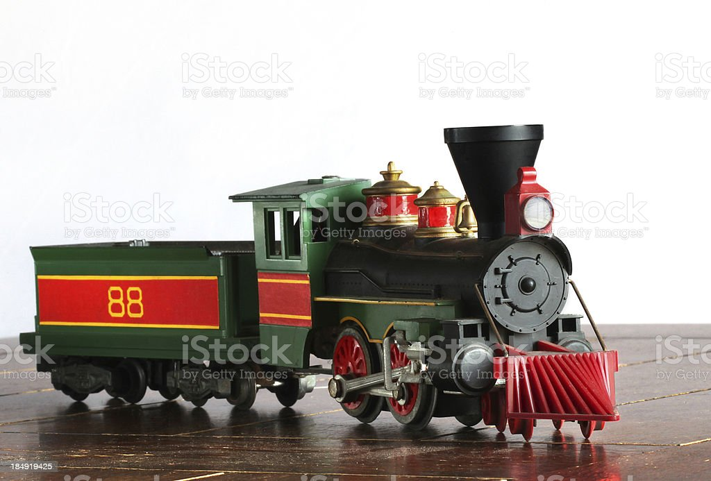 Antique steam engine and coal car.  Model train.  Copy space. stock photo