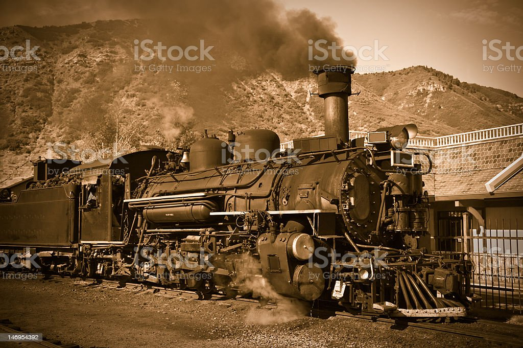 Antique steam locomotive in the American West stock photo