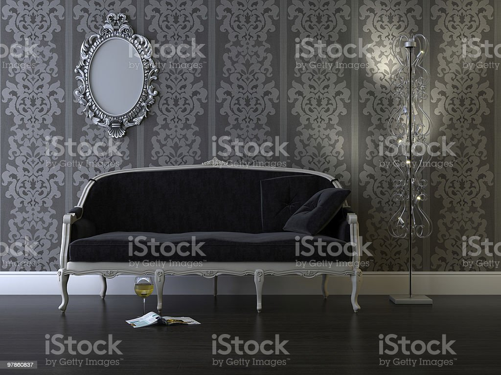 Antique style sofa in room with gray wallpaper and mirror stock photo