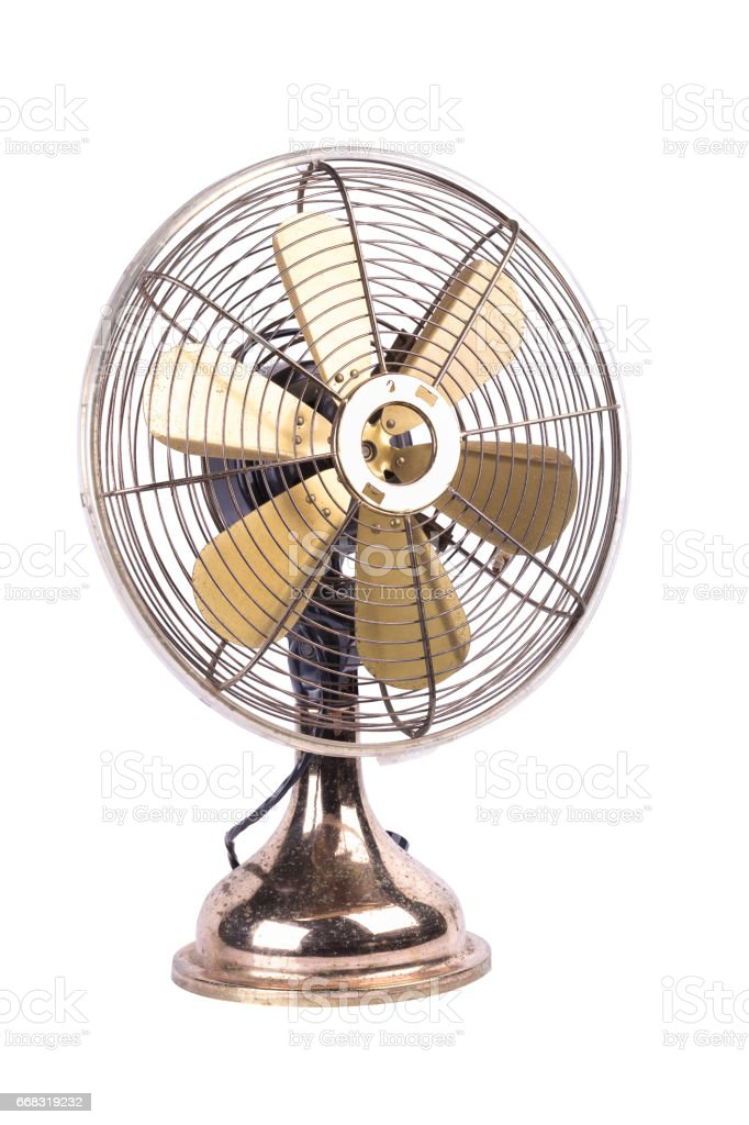 Antique table fan electric ventilator on white background stock photo