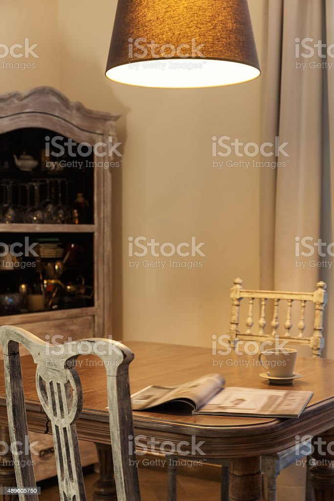 Antique table in old-fashioned interior stock photo