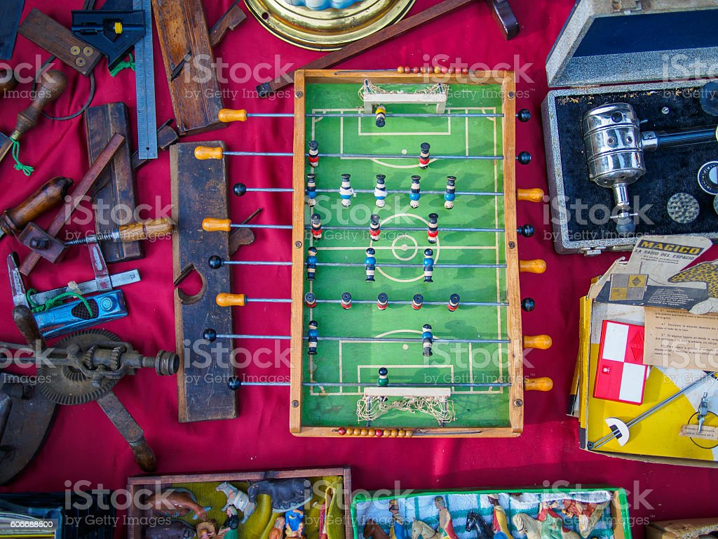 Antique table soccer surrounded by vintage objects - foto de stock