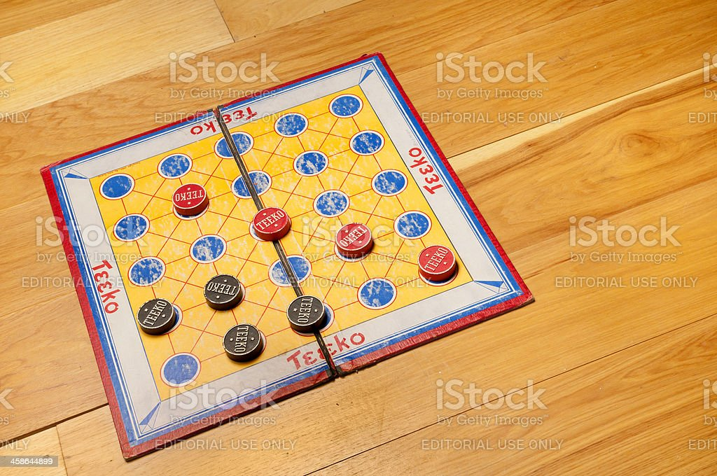 Antique Teeko Board with Game Pieces royalty-free stock photo