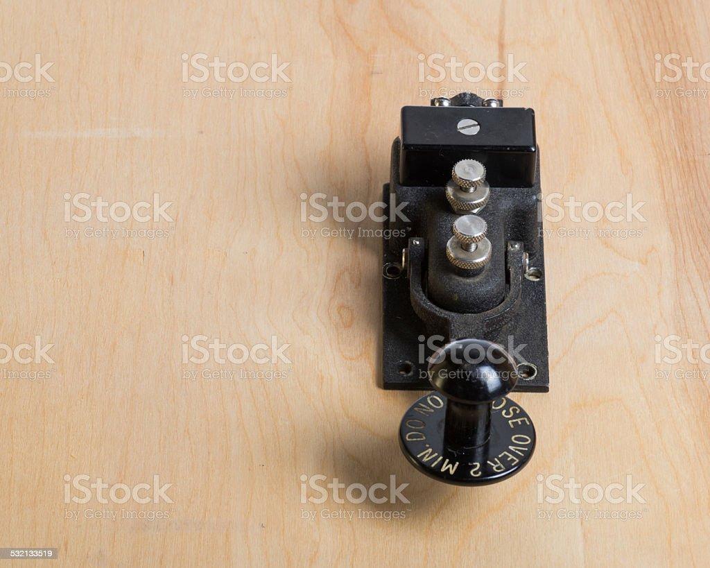 Antique telegraph key on a desk stock photo