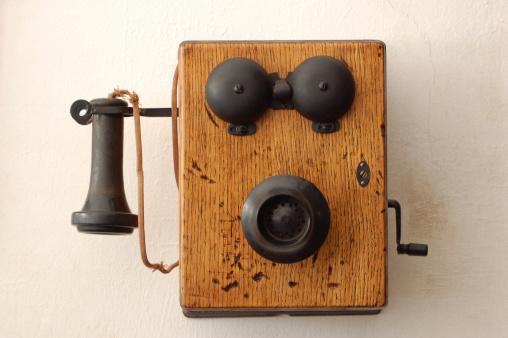 Shot of an antique wooden crank telephone.