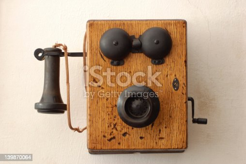 Shot of an antique wooden crank telephone.